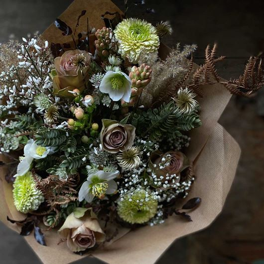 A festive bouquet featuring classic earth tones of winter.