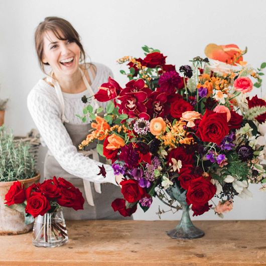 Floral designer arranging bold, beautiful blooms.