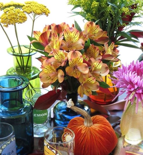 Solidasters, Alstroemerias, and yarrow (Achillea filipendulina), are featured in this late summer tablescape.