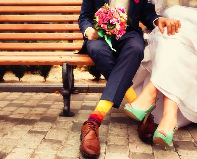 A just-married couple celebrates their nuptials with bright blooms.