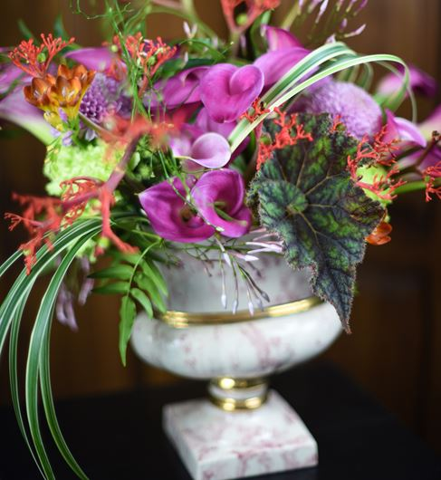 Antique porcelain urn displaying an eclectic mix of botanicals.