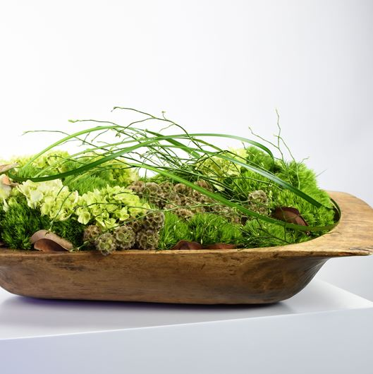 Dough bowl with Hydrangeas, Dianthus barbatus 'Green Trick', Scabiosa pods, Liriope muscari (lily grass), and Vaccinium (deciduous huckleberry). Photo: Jason Edwards