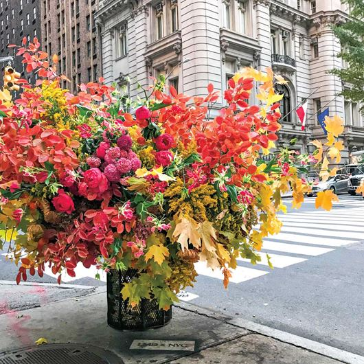 "A Lewis Miller Design ""flower flash"" decorates a New York City street."