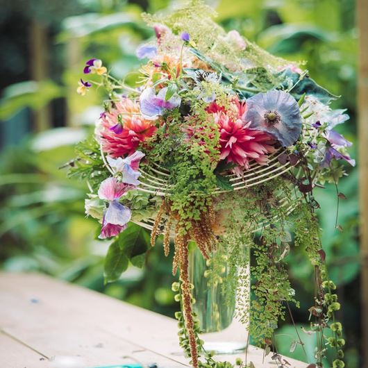 "Watercolor-esque hues and cascading botanicals are the showstopping elements of this arrangement, titled ""Inspired by the Structure."""