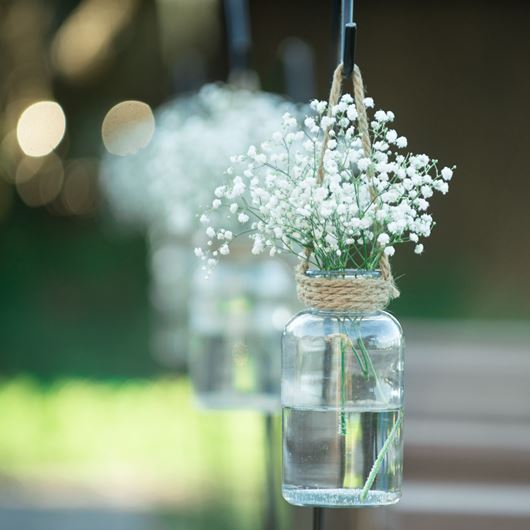 Simple outdoor decor featuring hanging vases with Gypsophila.