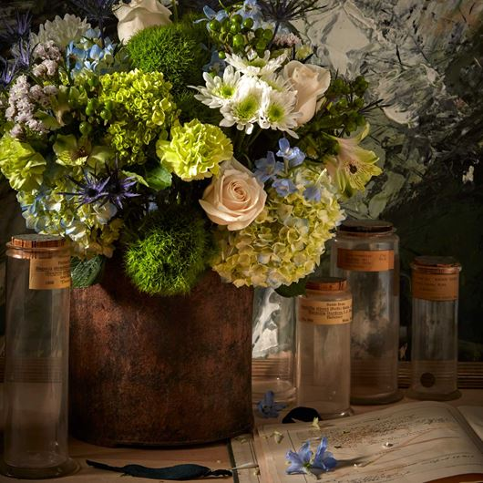 Inspired by the colors of nature, this centerpiece features assorted Hydrangea, roses, Hypericum, Eryngium and mums.