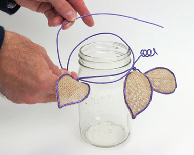 Use the remaining wire to wrap around the neck of the canning jar vase